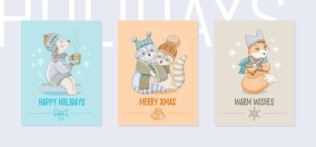 Merry christmas wenskaartenset. leuke posters met winterdieren met ijsbeer, wasbeer, vos