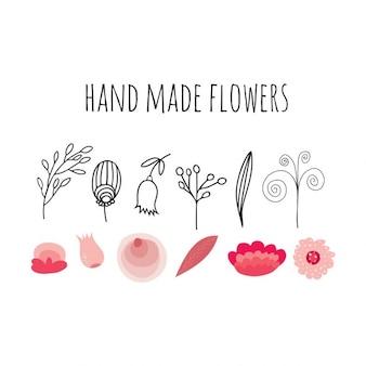 Met de hand gemaakt platte bloemen en bladeren