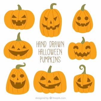 Met de hand getekende halloween pompoenen