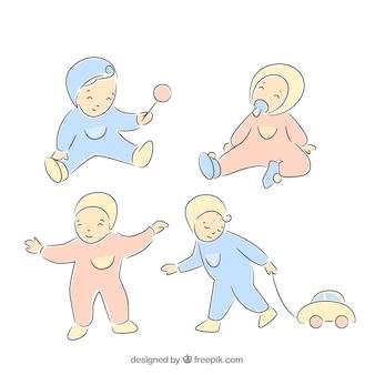 Met de hand getekende set van schattige baby spelen