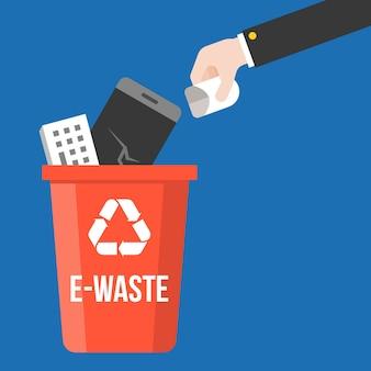 Met de hand plukken e-waste en kleurrijke prullenbak
