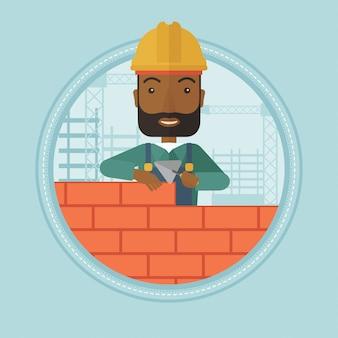 Metselaar bakstenen muur te bouwen