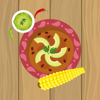 Mexicaans traditioneel voedsel met avocado en maïskolf