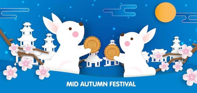 Mid autumn festival banner met schattige konijnen in papier gesneden stijl.