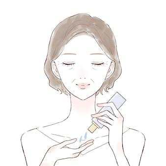 Middelbare oude vrouw die huidverzorgingsolie neemt. op witte achtergrond