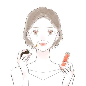 Middelbare oude vrouw die lipgloss toepast. op een witte achtergrond.
