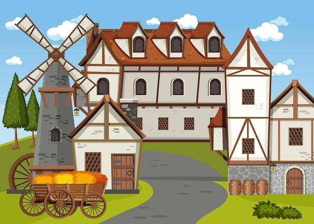 Middeleeuws dorpsgezicht met molen en huizen