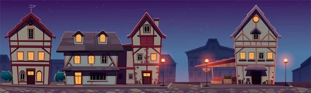 Middeleeuwse duitse nachtstraat met vakwerkhuizen.
