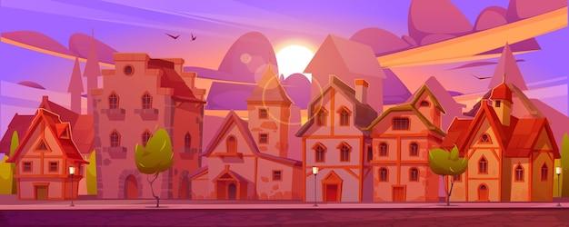 Middeleeuwse duitse straat met vakwerkhuizen bij zonsondergang