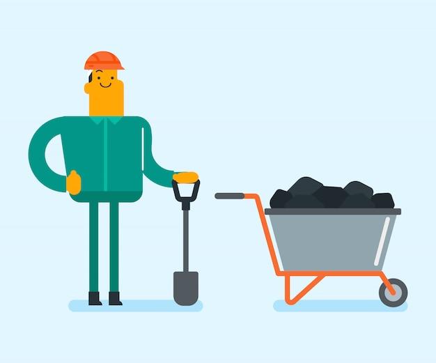 Mijnarbeider die met schop in de kolenmijn werkt.