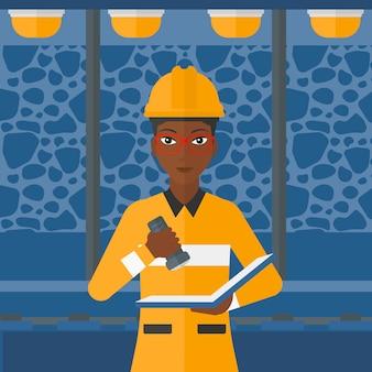 Mijnwerker die documenten controleert