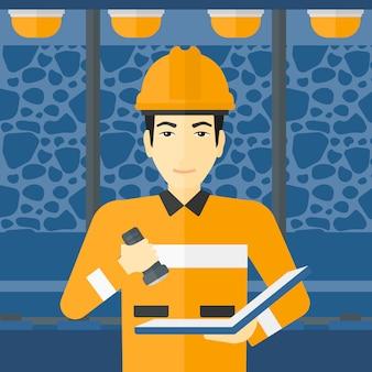 Mijnwerker die documenten controleert.