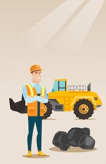 Mijnwerker met een grote graafmachine
