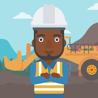 Mijnwerker met mijnbouwapparatuur
