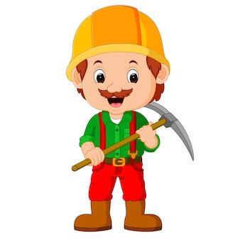 Mijnwerkers poseren met een houweel
