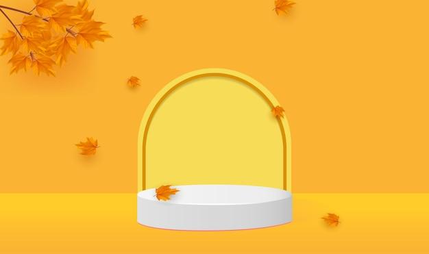 Minimaal geel geometrisch podium met vallende takken en blad