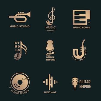 Minimale platte muziek logo vector design set in zwart en goud