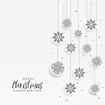 Minimale witte kerstmisachtergrond met sneeuwvlokken