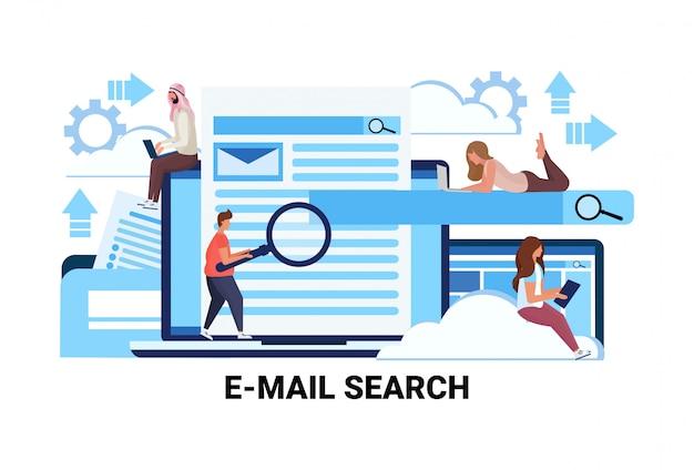 Mix race mensen vergrootglas zoom zoeken informatie e-mail zoeken concept