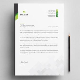 Modern bedrijfsbriefpapier met groene elementen