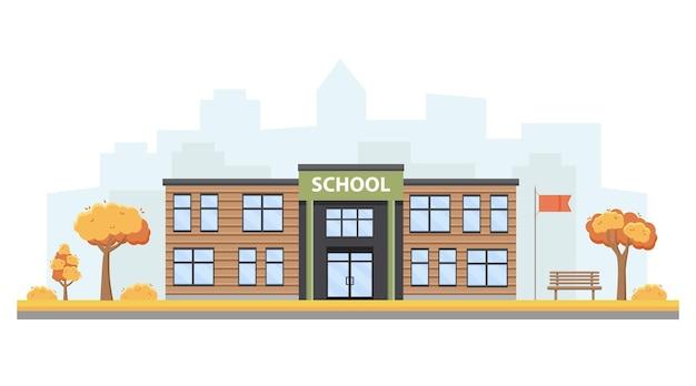 Modern schoolgebouw tegen de achtergrond van een herfstlandschap.
