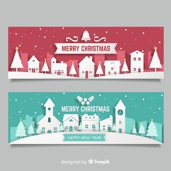 Moderne kerststad banners in papier stijl