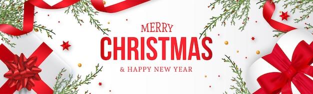 Moderne kerstwebsite banner met realistische kerstdecoratie achtergrond