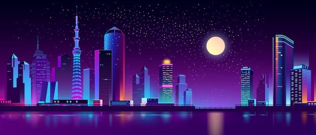 Moderne megapolis op rivier in de nacht