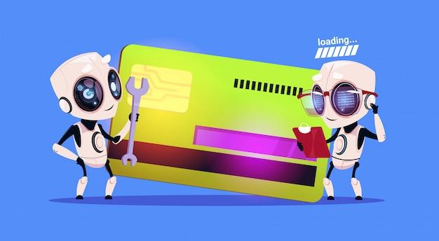 Moderne robots die zich over de documenten van de creditcardlezing bevinden en robotic technology payment concept van de moersleutel houden