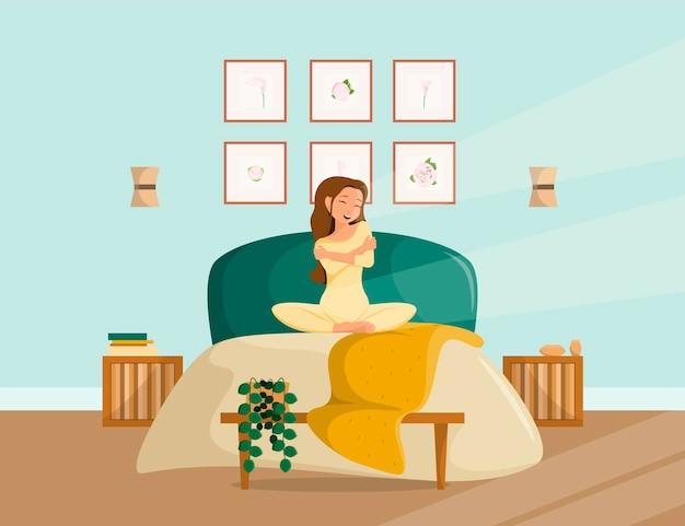 Moderne slaapkamer interieur. een jonge vrouw wordt wakker op het bed.