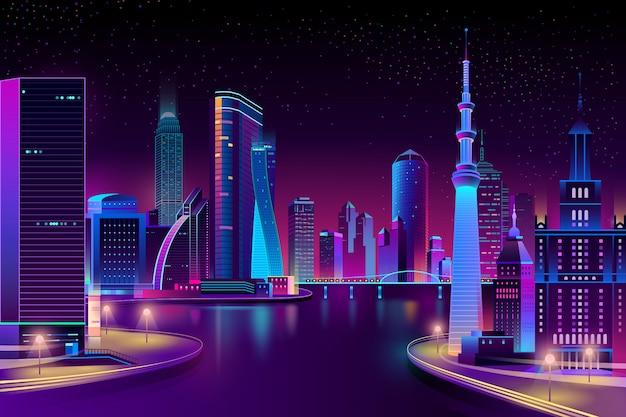 Moderne stad aan de rivier in de nacht.