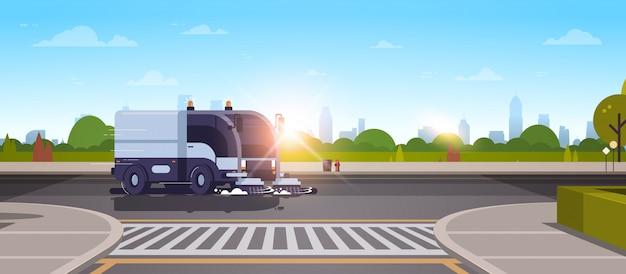 Moderne stad straatveger vrachtwagen asfalt wassen