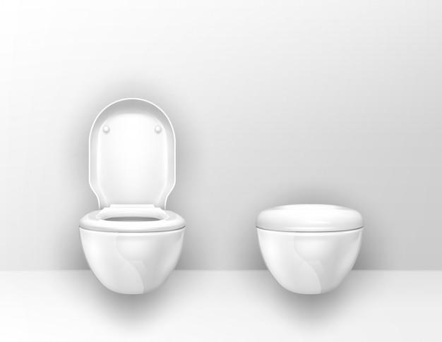 Moderne toiletpotten gemonteerd op muur in wc