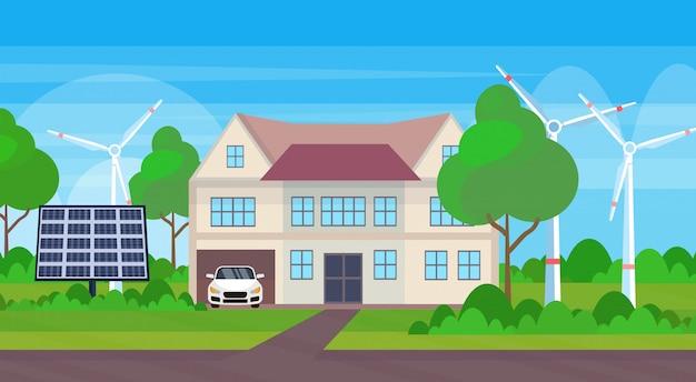 Moderne vriendelijke woningbouw met windturbine en zonnepaneel eco onroerend goed alternatieve energie concept landschap horizontale achtergrond