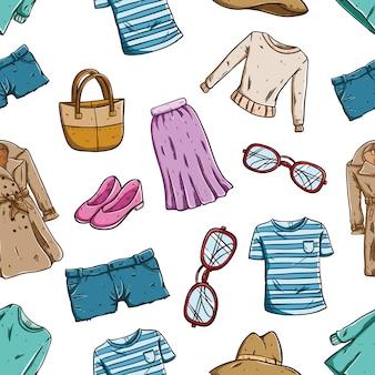 Modieus van vrouwenkleding en toebehoren in naadloos patroon
