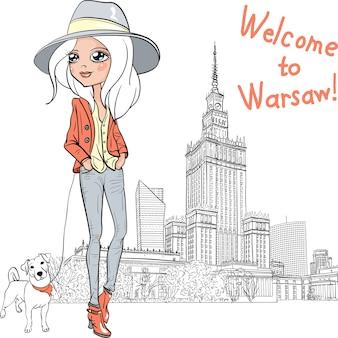 Modieuze hipster meisjestoerist in laarzen en hoed met schattige hond in warschau