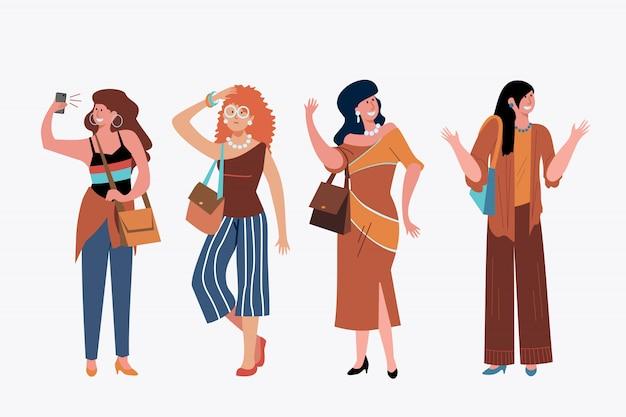 Modieuze jonge vrouwen buiten set