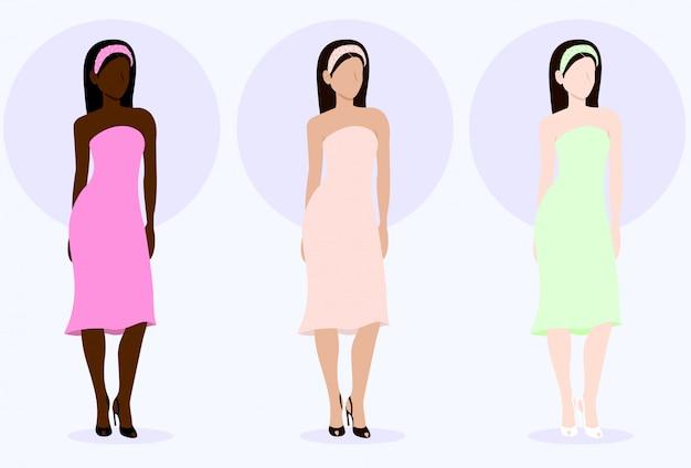Modieuze multi-etnische vrouwen staan in jurk en hakken