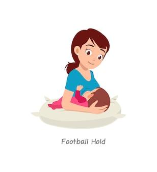 Moeder borstvoeding baby met pose genaamd voetbal hold