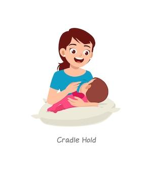 Moeder borstvoeding baby met pose genaamd wieg vasthouden