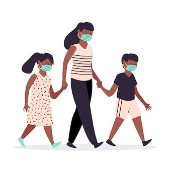 Moeder die met hun kinderen met medische maskers loopt