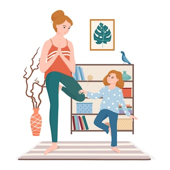 Moeder en dochter doen samen yoga, staande in vrikshasana, boom pose in de woonkamer
