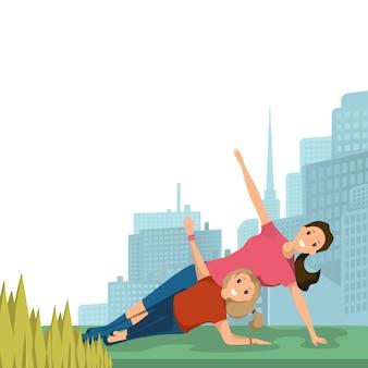 Moeder en dochter doen yoga sport stadspark