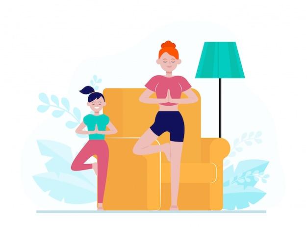 Moeder en dochter het beoefenen van yoga thuis