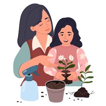 Moeder en dochter planten een bloem