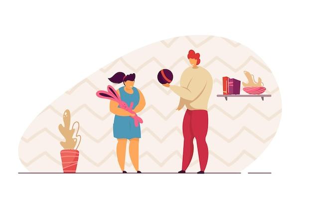 Moeder en dochter spelen speelgoed. moeder en dochter spelen bal en konijn. communicatie tussen ouders en kinderen. familieconcept voor website of advertentie
