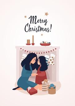 Moeder en dochter zitten bij de open haard en geschenkdozen