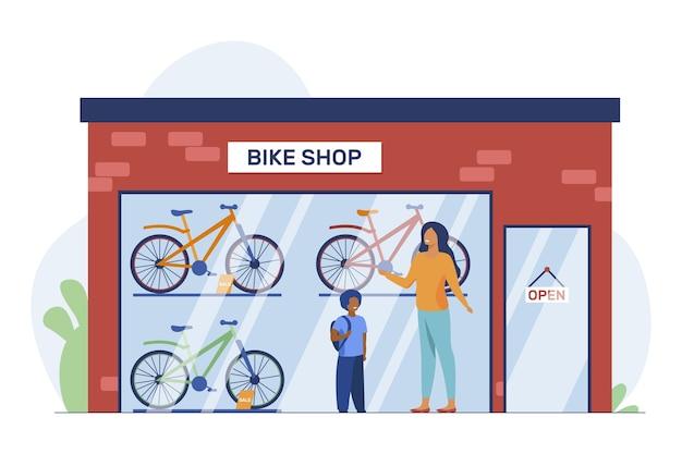 Moeder en kind kiezen fiets in fietsenwinkel. winkel, zoon, ouder platte vectorillustratie. vervoer en actieve levensstijl