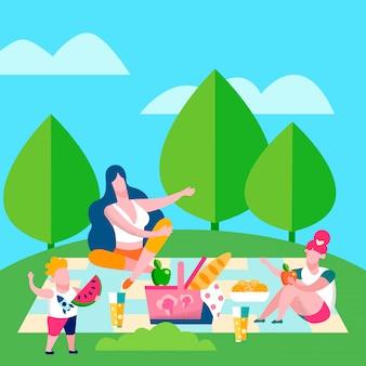 Moeder en kinderen picknick