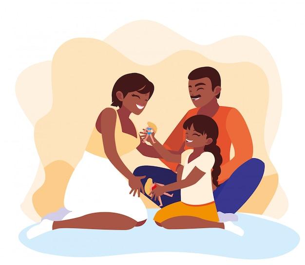 Moeder en vader met dochter spelen